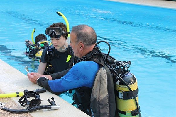 child having scuba diving lesson