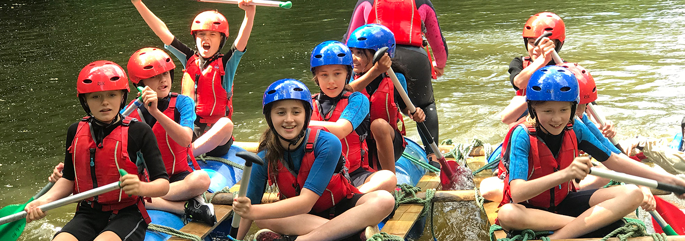 group of children kayaking