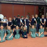 All children of the class sat or stood outside smiling for a group photo